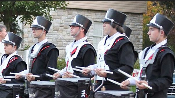 Drumline marching at homecoming parade